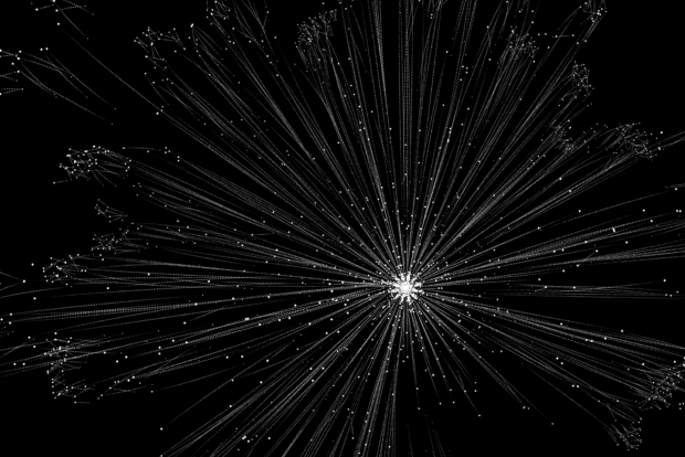 A series of small white dots arranged in a radial pattern on a black background